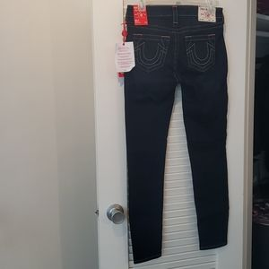 Skinny blue jeans.